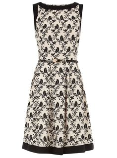 Ivory and black bird print circle dress with black contrast tipping around neck and armhole. 100 viscose. Machine washable.