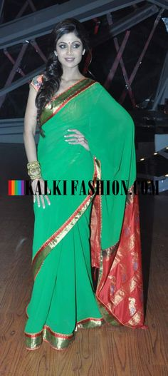 http://www.kalkifashion.com/ Shilpa Shetty in green saree with red and gold pallav on the set of Nach Baliye Semi Final round