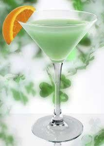 Green Magic made with Vodka and OJ shaken together and poured into the glass, then pour blue curacao in and it magically turns green
