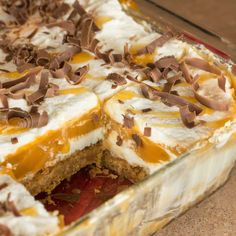 Butterscotch Lush is a 4-layer dessert of graham cracker crust, cream cheese, pudding, and whipped cream. Topped with butterscotch and chocolate shavings.