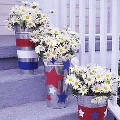 tin floor pots lining front steps. CUTE!