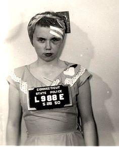 Mug shot, 1950. Wonder what's the story behind this photo... perhaps domestic violence? Girl gang?