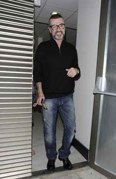 George Michael Photos Photos - Singer George Michael leaves a hotel via the back door at 1am with some friends in Park Lane, London. - George Michael Out in London