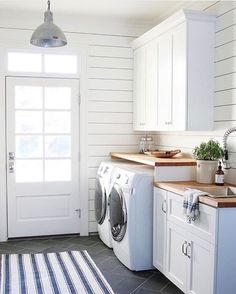 Love this bright laundry room!