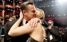 The 'Titanic' co-stars embraced after his name was read as best actor in a leading role, marking his first Oscar win.