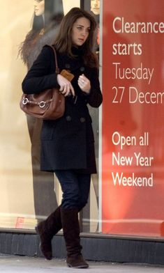 Duchess Catherine in black coat, jeans, brown boots, and brown handbag while doing after-Christmas sales, December 2006