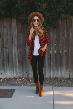Lumberjack button down, white top, skinnies, cognac ankle boots.