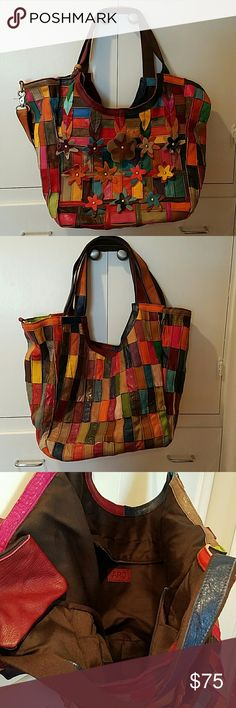 APC leather patchwork handbag/tote This is an absolutely amazing piece of work! It's big: 18x12. It has two shoulder straps, a removable, adjustable strap, and a little wristlet that comes with it along with its dust cover bag. Inside it has two open pockets, one zipper pocket and a zipper closure. APC Bags Shoulder Bags