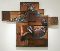 Belgian artist ROA (previously) just opened his first solo show at Jonathan LeVine Gallery in NYC titled Metazoa. The new series of mixed media works feature the artist's familiar black and white depictions of animals painted on various cabinet-like furniture pieces that can be opened or shifted to reveal anatomical details. roa-3