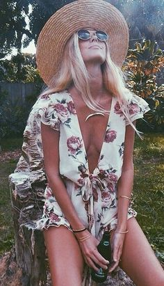 cute romper.. good example of why a real tan from the sun makes you look like the old lady from  Theres Something About Mary