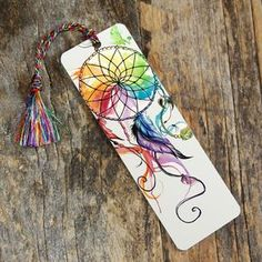 This bookmark features our newest and highest-quality bookmark style: a rigid, high resolution lamination print with rounded edges. Measures roughly Includes a tassel in a color that compliments the image. Tassel color may differ from one shown i Creative Bookmarks, Diy Bookmarks, Watercolor Bookmarks, Watercolor Art, Dream Catcher Watercolor, Dream Catcher Painting, Watercolor Dreamcatcher, Bookmark Craft, Bookmark Ideas