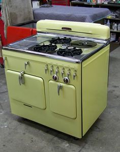 My grandmother had a white one just like this! She had her iron match box cover hanging on the wall beside it to light.