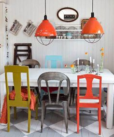 Mixed Dining Chairs In Dining Rooms. Love the floor and orange lights.