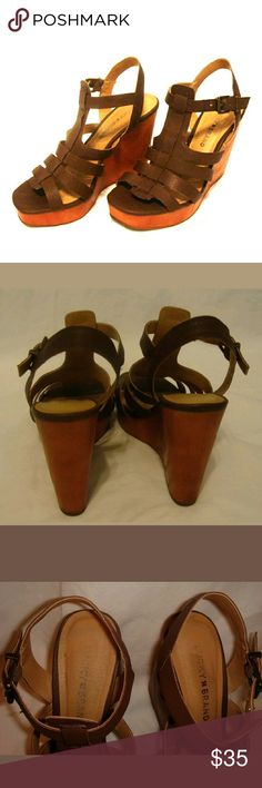 """Lucky Brand Brown Wedged Platform heels Lucky Brand brown platform wedged heel size 7.5. Heel height: 4 & 1/2""""  - Pre loved  - Excellent condition, only fading of Logo on sole as seen in photo. - Open to reasonable offers Lucky Brand Shoes"""