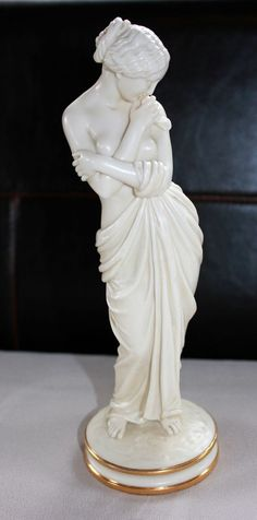 Rare And Exquisite Parian Figurine Marked For The Fine English Worcester Firm Kerr & Binns, The Nude Maiden Holding A Drape Around Her Waist And Crossing Her Arms Across Her Chest, Her Right Hand Holding A Small Bird, She Stands On A Circular Base With Gold Trim    Circa 1852