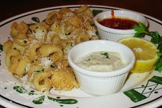 Tender calamari, lightly breaded and fried/ with parmesan-peppercorn and marinara sauces.
