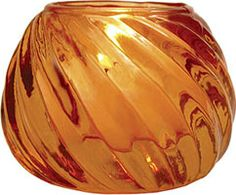 Orange Vintage Colored Glass Candle Holder (swirl design).  Dimensions: 2.75 inches x 2.25 inches high. Creates a candle light atmosphere with the added sparkle of colorful vintage glass. Perfect for weddings! Intended for use with tealight candles, wax or battery operated.