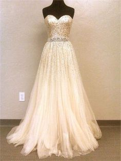 If anyone knows me they know I love glitter and rhinestones! Perfect wedding dress