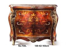 An elegant Louis XV style ormolu-mounted colored marquetry marble topped bombe commode with three deep drawers and stunning marquetry patterns representing different floral motifs, the ormolu is finely chiseled representing two winged maidens on corners and engraved ormolu strips surrounding the cabinet on all edges and central top and below foliage ormolu motif. Terminating with finely chiseled foliage ormolu sabots.