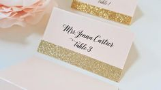 Blush & Gold Glitter Place Cards Save time handwriting your placecards by purchasing these oh so glam seating cards! Glittery gold, these shimmery placecards are perfect for any event and will look elegant gracing any table. Best of all, these glitter place cards never shed and can be printed on either a pretty blush or pearl shimmer. ♥ YOUR ORDER INCLUDES ♥ 2 x 3.5 Folded and Printed Placecards Gold Glitter Strip Placed on the Bottom Edge Printed on Pearl or Blush Shimmer Cardstock Blac...