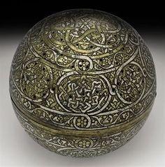 A Mamluk silver-inlaid pierced brass incense-burner, Egypt or Syria, 15th century