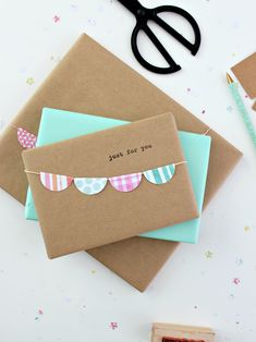 If you're looking to do just a little more when wrapping your next gift, this project is simple and quick, but not at all boring.I selected scrapbook paper in