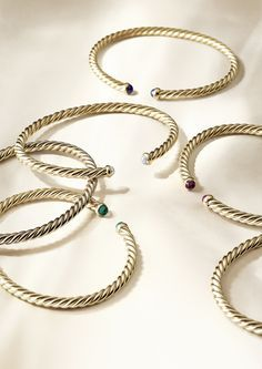 Petite Precious Cable bracelets in 18k gold with gemstones.