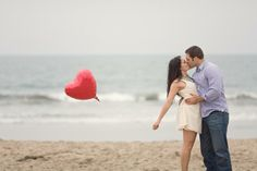 love this photo such a cute idea for engagement photos!