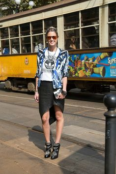 """Milan Fashion Week: Helena Brunner, blogger """"My jacket is by Roberto Cavalli and my skirt is by Helmut Lang. I'm wearing a T-shirt by Adidas, Tod's shoes and a Camila Klein necklace. My rings are by Carla Amorim."""""""