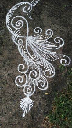 Simple peacock rangoli