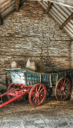 ♂ Aged with beauty - Old green wagon with red wheels in barn