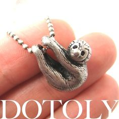 Sloth Necklace. Slowly killing me w/its cuteness.