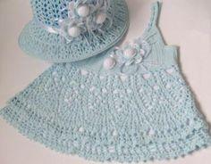 light blue crochet baby dress and flower embellished hat