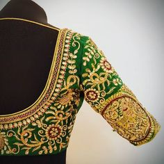Red Gold and Green !! The perfect colours for a traditional blouse . Beautiful green color designer blouse with floret lata design hand embroidery thread and kundan work. 24 November 2017