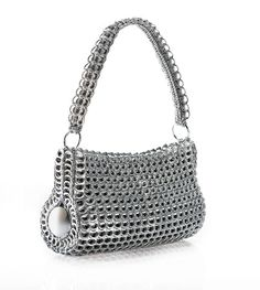 danubia shoulder bag - Hand crocheted by fair trade cooperatives in Brazil Made with over 700 recycled soda can tabs. Gussets made from recycled aluminum can bottoms.