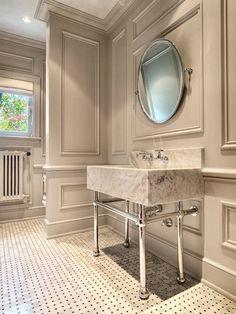 JAS Design Build - bathrooms: gray crown molding base boards, wall moldings, gray decorative wall moldings, oval pivot mirror, marble slab washstand, marble basketweave tile floor.