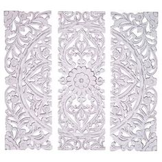 Bring eye-catching style to your home decor with this charming design, artfully crafted for lasting appeal.  Product: Set of 3 wall panelsConstruction Material: WoodColor: Matte whiteFeatures:  Hand-carved floral and leaf motifsTraditional designs Dimensions: 36 H x 12 W x 1 D each