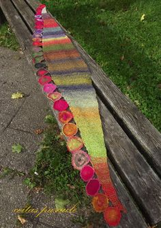 ceitaspasaule: fleurs Noro. This is a fabulous scarf! Reminds me of your Welcome Toran, Jean Moss...