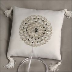 WeddingDepot.com ~ Ring Bearer Pillow - Glam Gal ~ The front of the pillow is boldly accented with sparkling silver beads that form a circle of radiating hearts. Each corner has its own small tassle for added elegance.