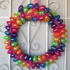 Bright Easter Wreath! Ribbon, plastic eggs, grass, cardboard, hot glue, kids plastic bracelet for the hanger!