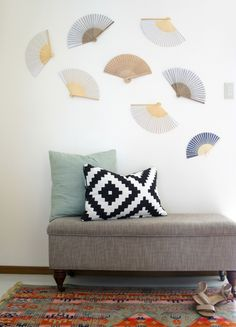 Foyer Fan Wall- Hang dollar store fans backwards with command strips for a hole free, neutral wall decor! Great for renters.  - Up to Date Interiors
