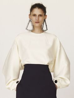 607ac21fad Céline s Shoulder-Dusting New Earrings Up the Ante on Statement Jewelry