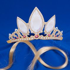 This is a free rapunzel crown Printable ... this could be Glued to a stabalizer material, for added strength.