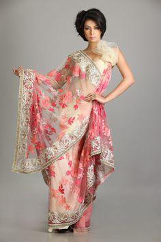 Cream sari with pink floral work $465