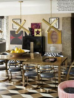 Dinette - Amazing floor tiles, love the nail size perforations on the tables/legs, the 2 pendant 'X' light fixtures are bang on, the stools and all the other chosen elements are on spot on....this is one cleverly conceived Eclectic space!  Love the edgy choices.  Bravo!