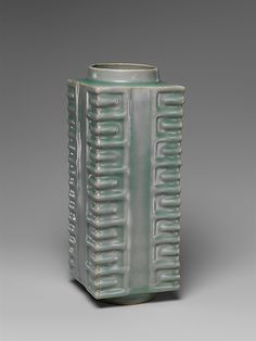 MOMA-Vase in Shape of Neolithic Jade Cong  Period: Southern Song dynasty (1127–1279) Date: 12th–13th century Culture: China Medium: Porcelain with raised decoration under celadon glaze (Longquan ware) Dimensions: H. 10 3/8 in. (26.4 cm); W. 4 in. (10.2 cm); D. 4 in. (10.2 cm) Diam. of rim: 3 in. (7.6 cm) Diam. of foot: 3 1/8 in. (7.9 cm) Storage Box: 11 7/8 x 5 5/16 in. (30.2 x 13.5 cm)