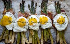 Bacon wrapped asparagus with fried egg and melted gouda