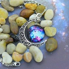Jiayiqi Women's Galaxy Crescent Moon Galactic Universe Cabochon Pendant Necklace If you know someone who loves outer space consider getting them unique and cool unique space gifts for adults. These gifts are truly amazing on a galactic scale. You will appreciate these gifts include outer space home décor, super cool cosmic jewelry and super outer-space home décor. Either way these gifts are great for those in love with the cosmos