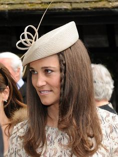 Pippa wore a beige Whiteley hat, the same style as worn by her sister the Duchess of Cambridge and a small plait at the front of her hair.