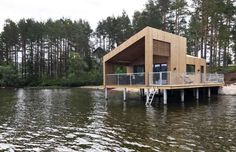 """A tiny house on stilts has been constructed above a Norwegian lake. A """"floating home on water"""" desig... - Feste Architecture"""